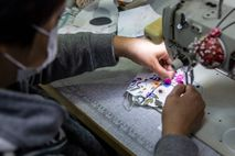 Tailor Elase Wong making masks out of patterned material at a shop in Hong Kong on ...