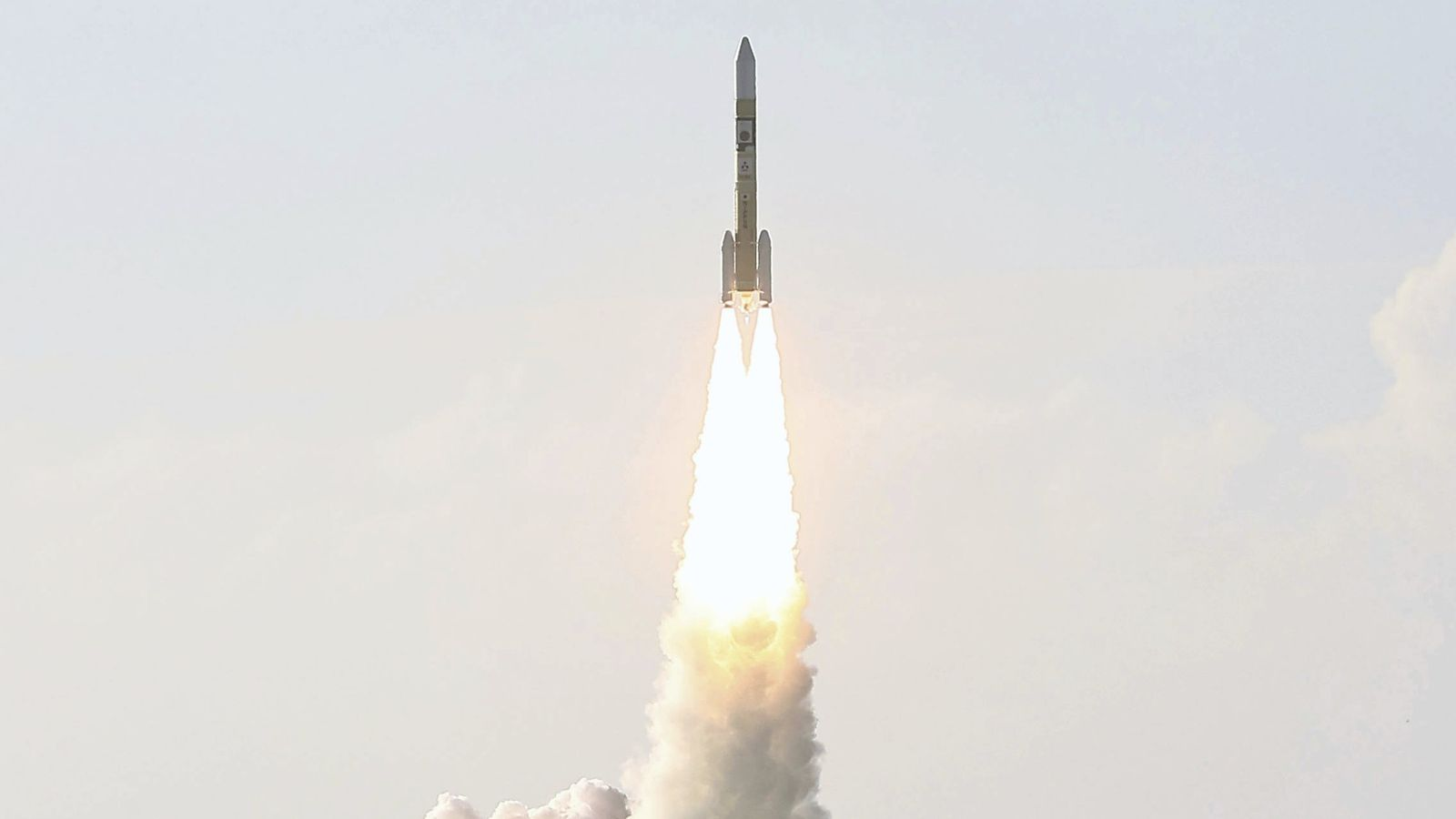 A Japanese H-IIA rocket lifts off with the Hope spacecraft, a Mars orbiter developed by the ...