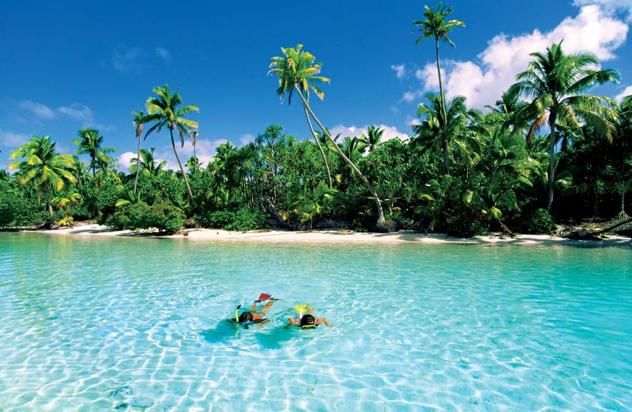 Snorkelers enoy the clear waters of One Foot Island in Aitutaki, Cook Islands.