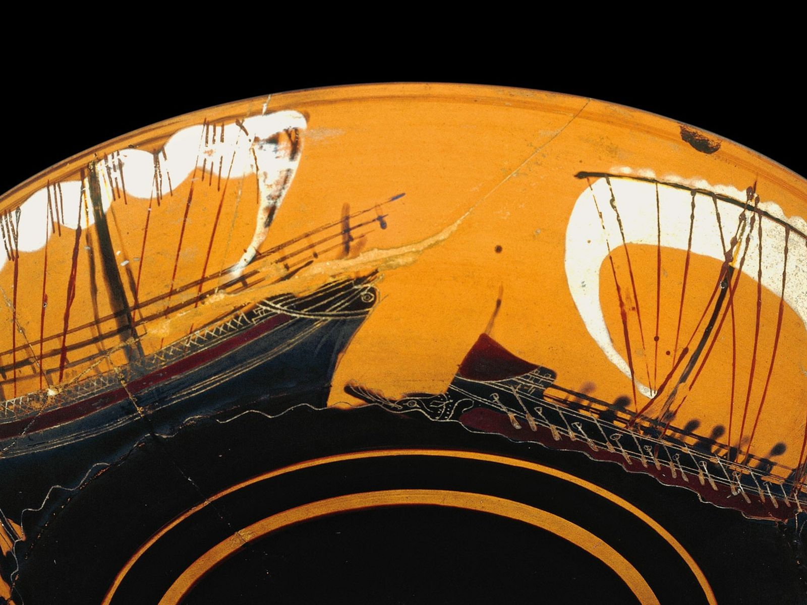 Merchant ships, such as that on the left of this sixth-century B.C. Greek bowl, were targets ...
