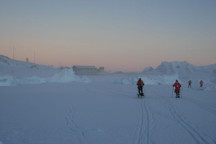 Researchers out on the sea ice near Rothera Research Station. Situated on an island off the Antarctic ...