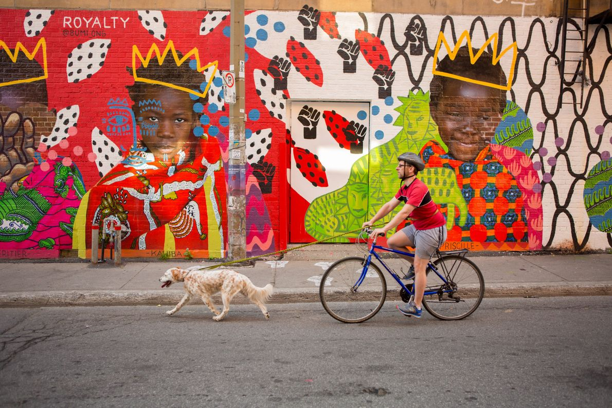 Travel through any one of Montreal's neighbourhoods and you can enjoy the dramatic and colourful mural ...