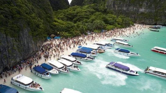 Boats lining up in a lagoon in Krabi, Thailand