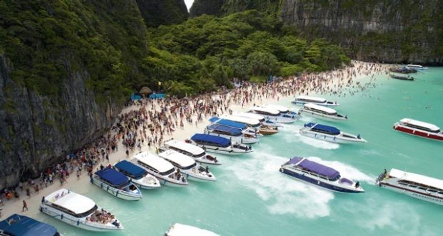 Boats lining up in a lagoon in Krabi, Thailand.