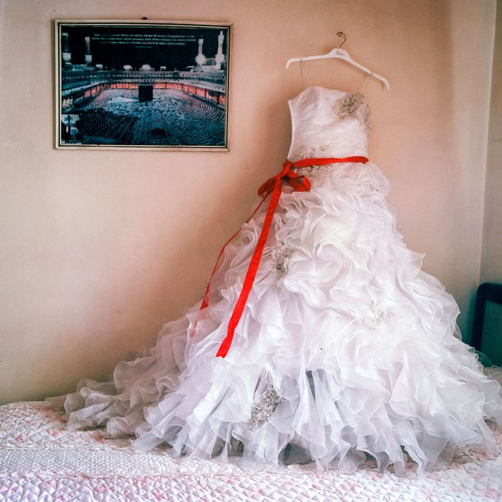 The dress worn by a 14 year-old bride to is laid out after her wedding day ...