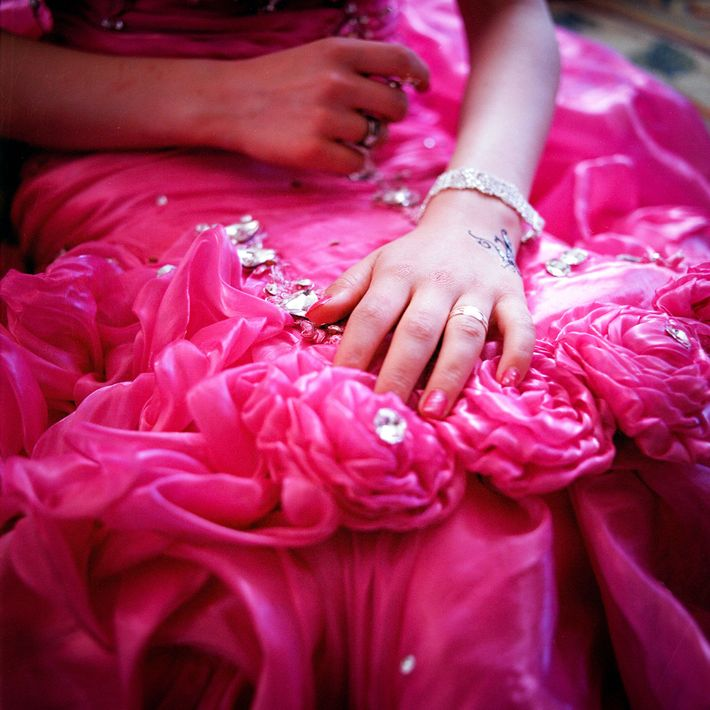 """H. shows Sebzeci her engagement ring and dress before her engagement party. """"H. asked for a ..."""