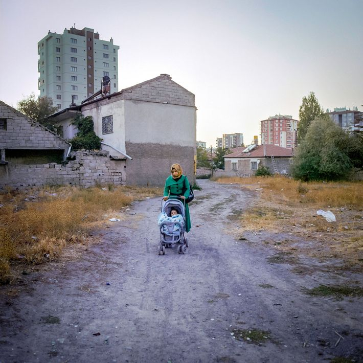 M., 17, pushes her daughter in a stroller outside their home in Kayseri. M. was married ...