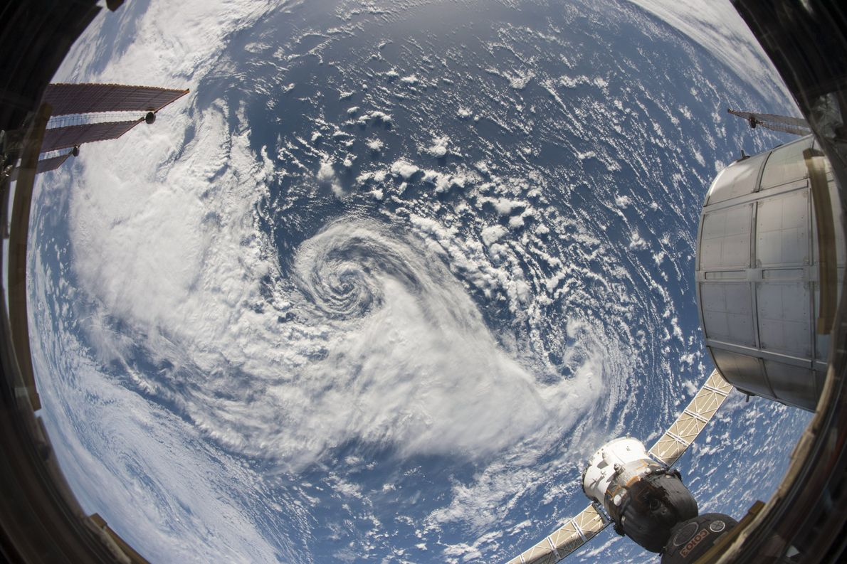Clouds swirl in a storm over the North Pacific. This spiral pattern is one that is ...