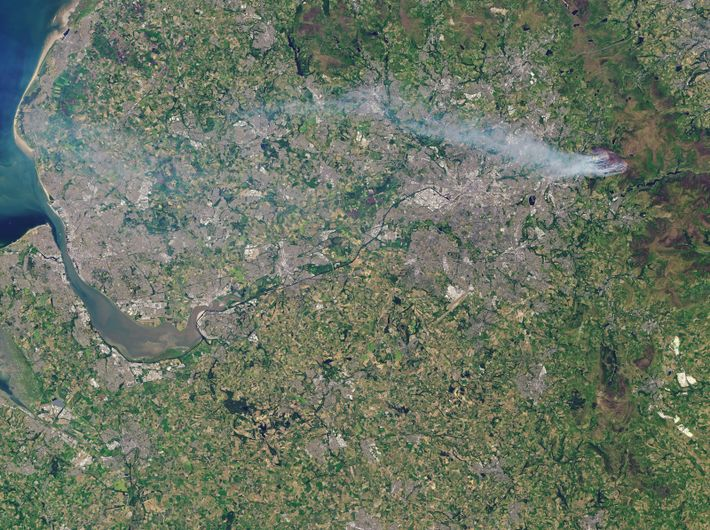 A NASA image of northern England shows smoke plumes carried on the air from the Saddleworth ...
