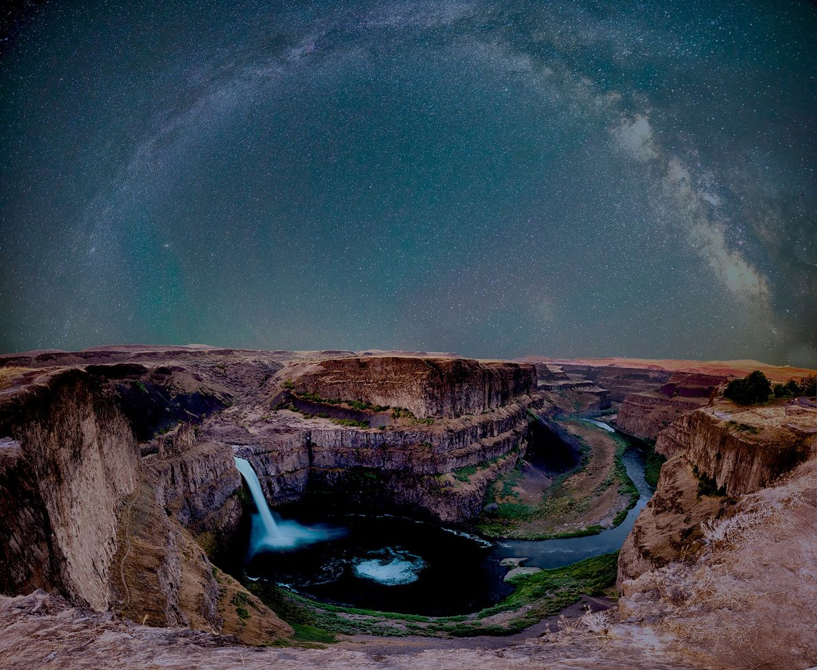 The Milky Way arcs over Palouse Waterfall in Washington State.