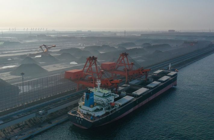 A new coal project goes into action in northern China. Experts say such energy infrastructure locks ...