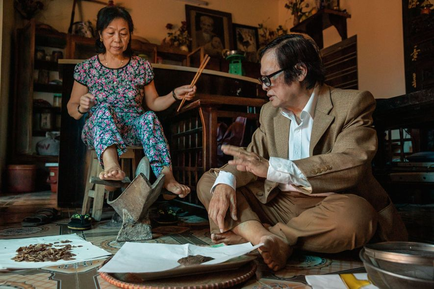 In Vietnam a sixth-generation traditional medicine practitioner demonstrates how he prepares herbs to mix with the ...