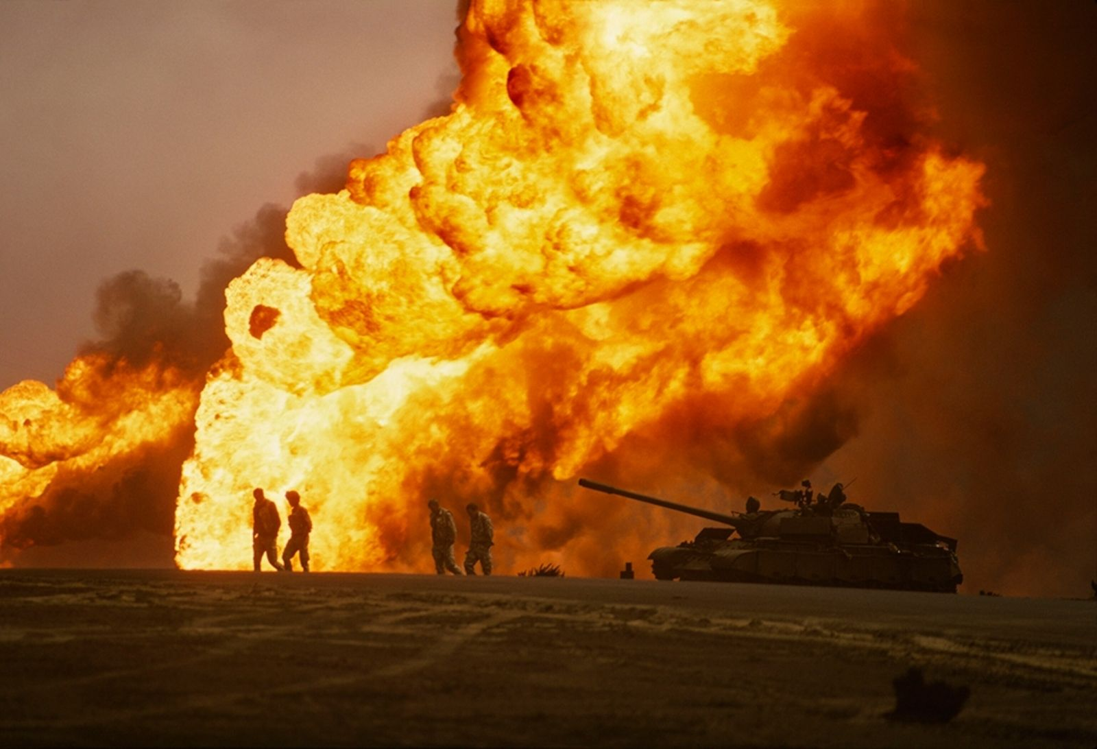 Retreating Iraqis set the Burgan oil fields ablaze. Soon an oily, toxic cloud more than 30 ...