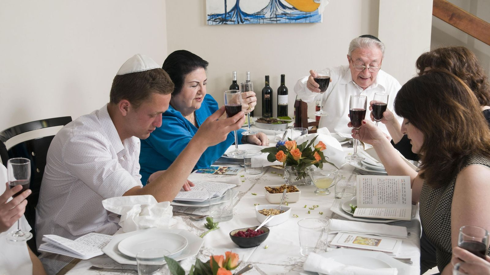 A family gathers for a seder, the ritual meal that celebrates Moses freeing the Israelites.