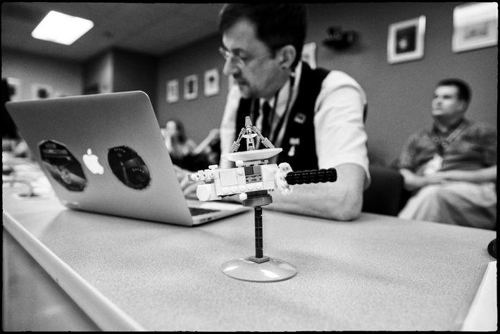 New Horizons co-investigator Paul Schenk, the mission's lead on mapping Pluto, works away at his laptop ...