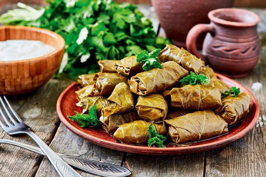 Dolma are parcels of rice and minced meat such as beef or lamb wrapped in grape ...