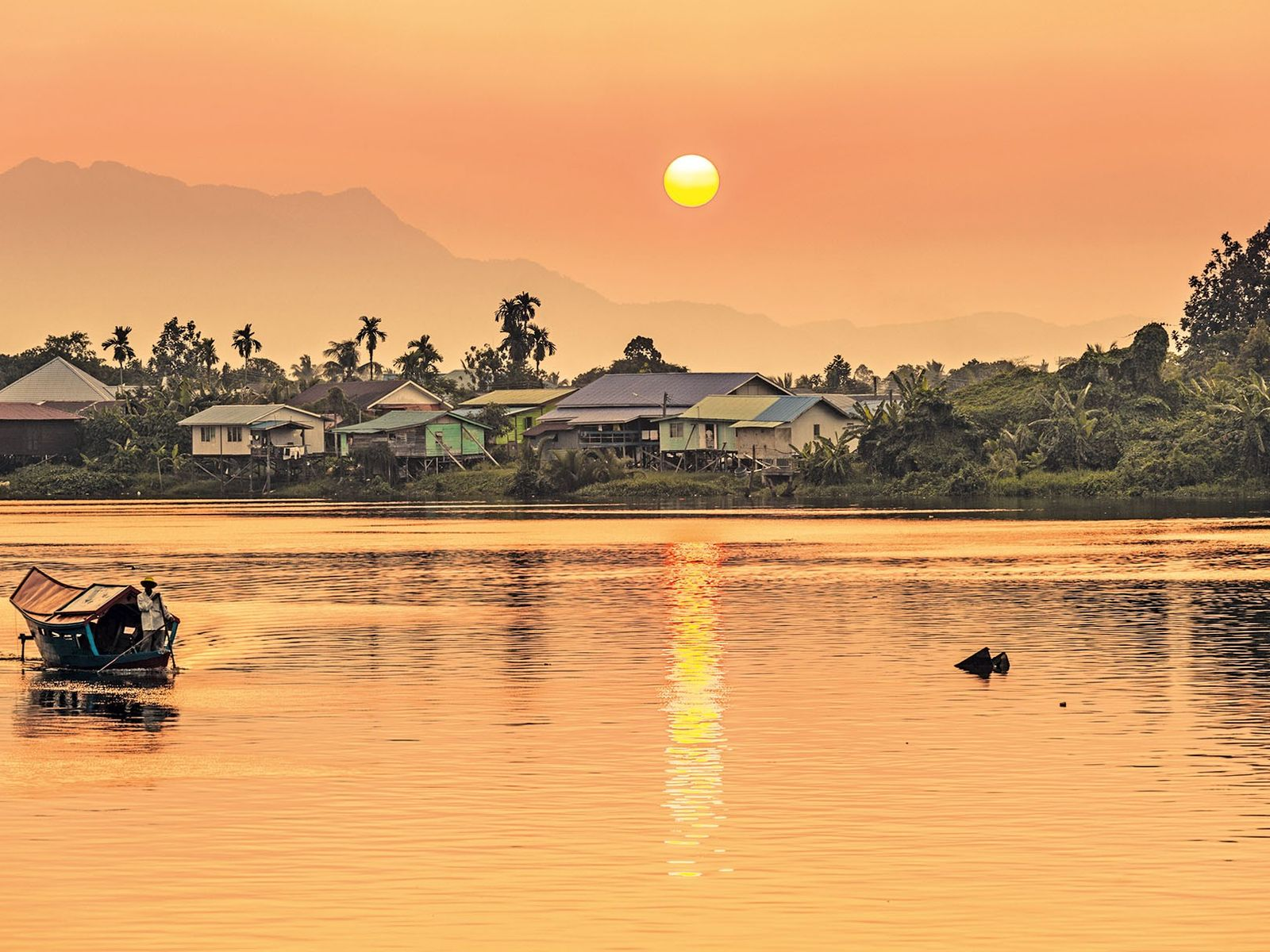 The Sarawak River runs through Kuching's centre and is an important source of water, as well ...