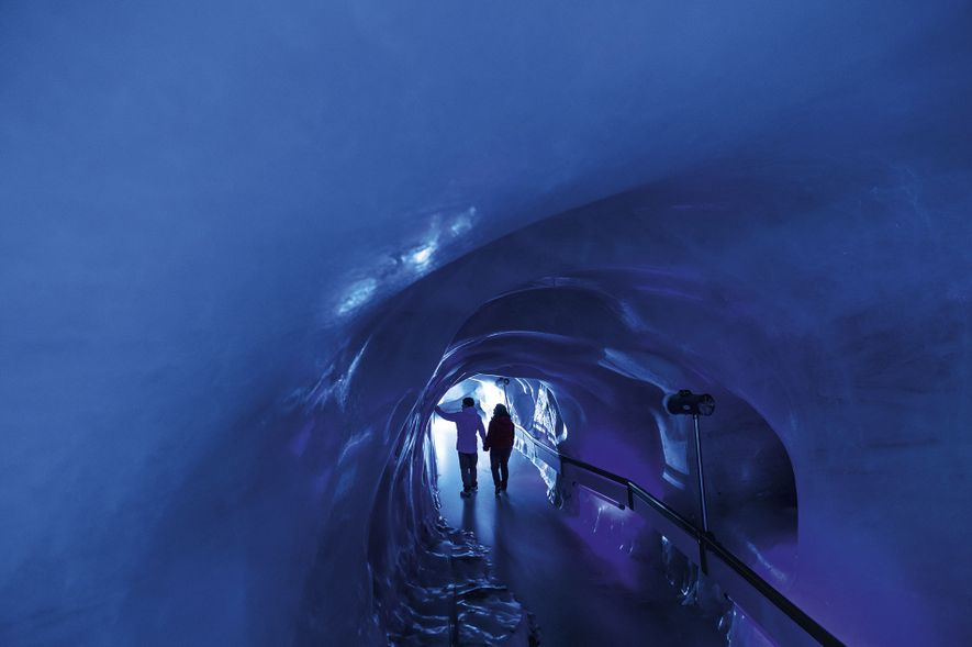 The Swiss ski resort of Engelberg offers ample excitement for visitors even when they're not skiing, including exploring Titlis Glacier Cave, the turquoise heart of Titlis mountain.
