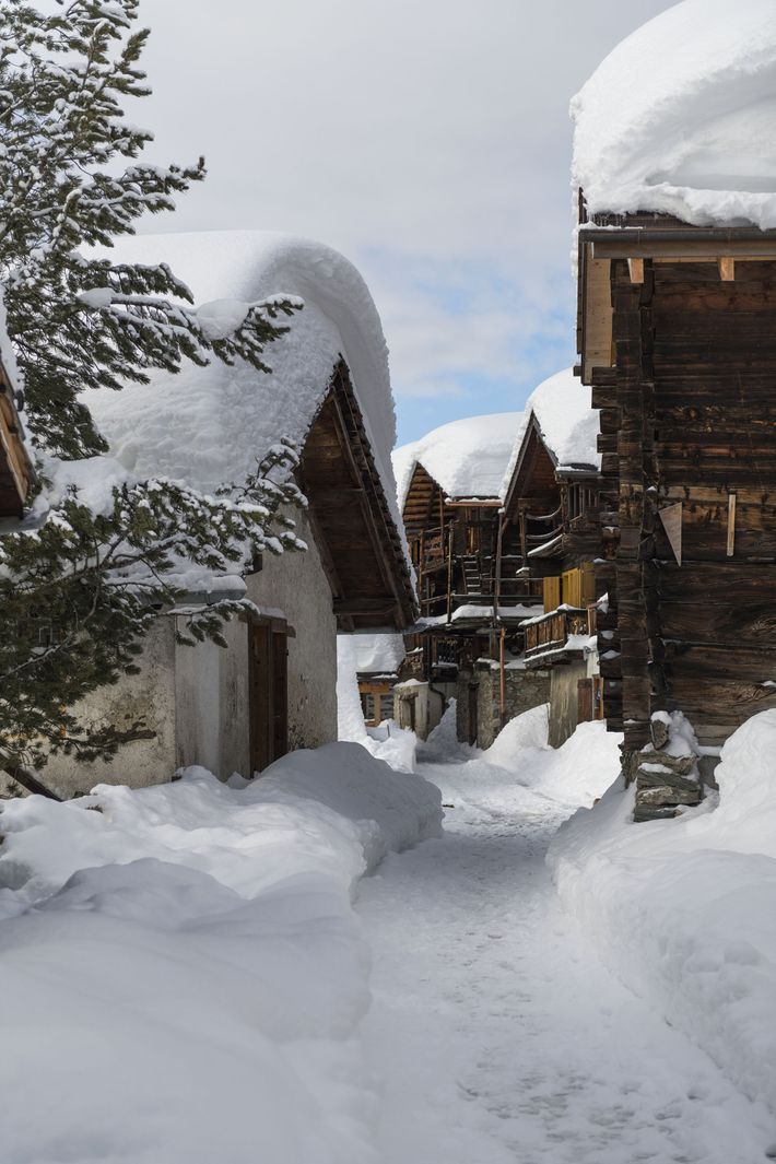 Snow-covered chalet roofs.