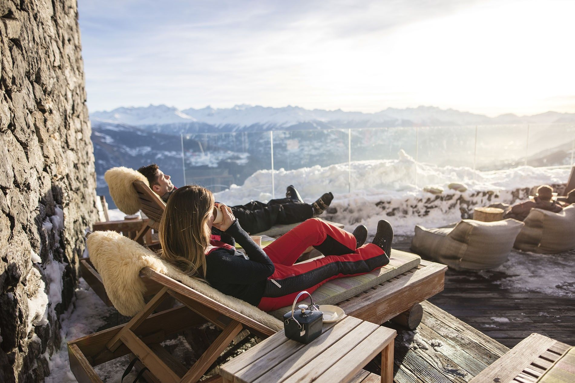 Après ski at Chetzeron Hotel Crans-Montana, a ski resort in the Valais region with far-reaching views over mountain peaks unfolding from Bietschhorn to Mont Blanc.