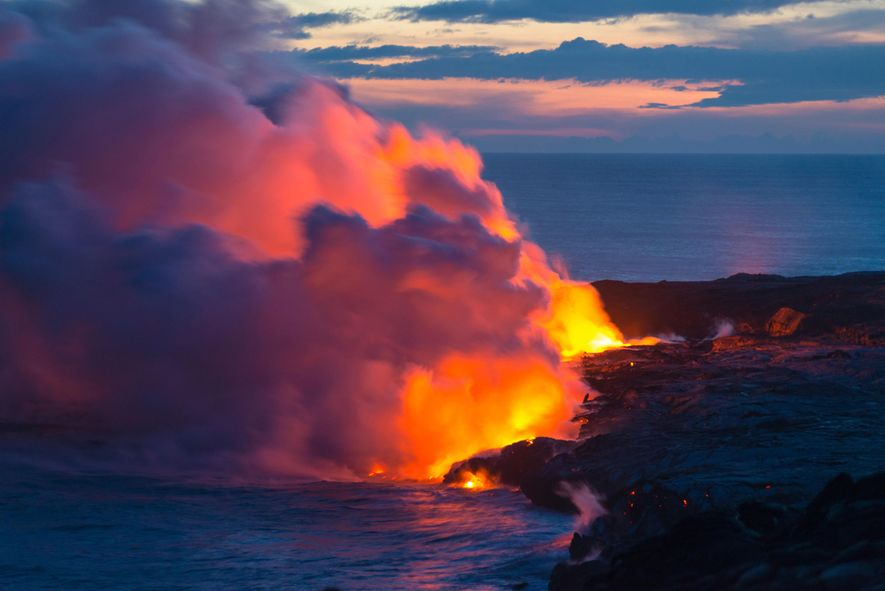 Steam rises as lava pours into the Pacific Ocean on the Big Island of Hawaii.