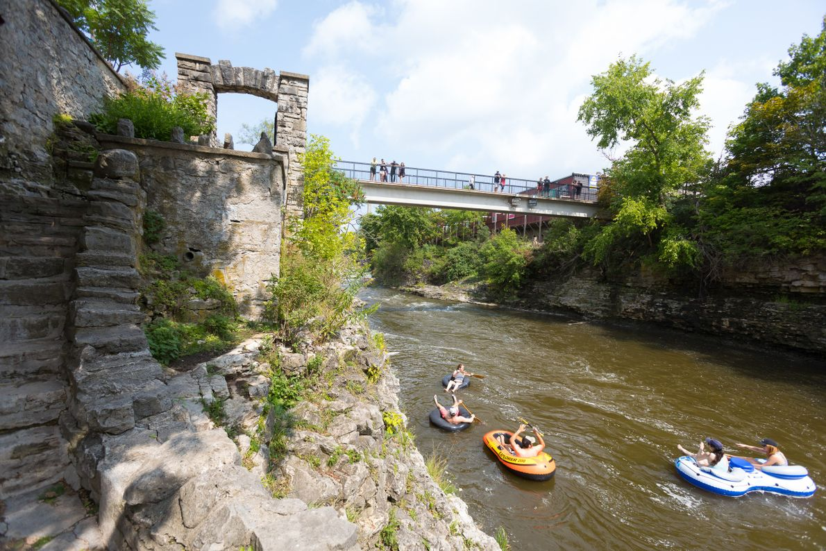 People tubing on the Grand River by way of the Templin Gardens in Fergus.