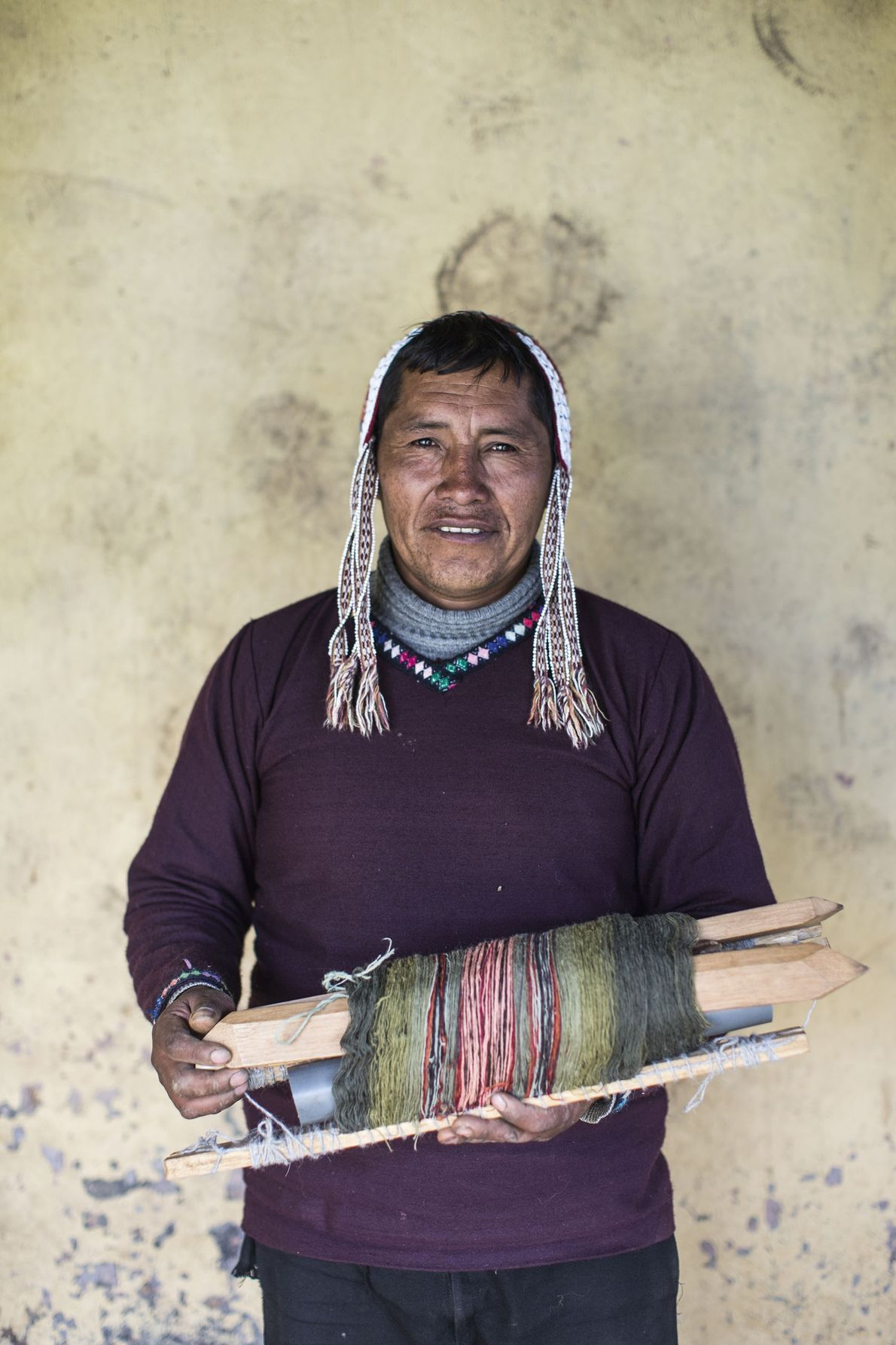 Holding woven fabric made traditionally