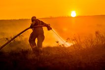 Saddleworth Moor, 2018.Fire fighters damp down the burning moorland above Carrbrook, during a three-week wildfire on ...