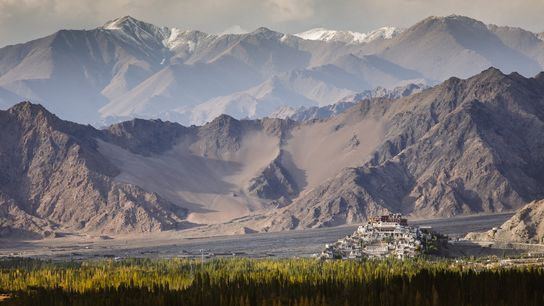 The dramatic mountainscape of the Indus Valley region of Ladakh, Northern India, with the 15th-century Buddhist ...