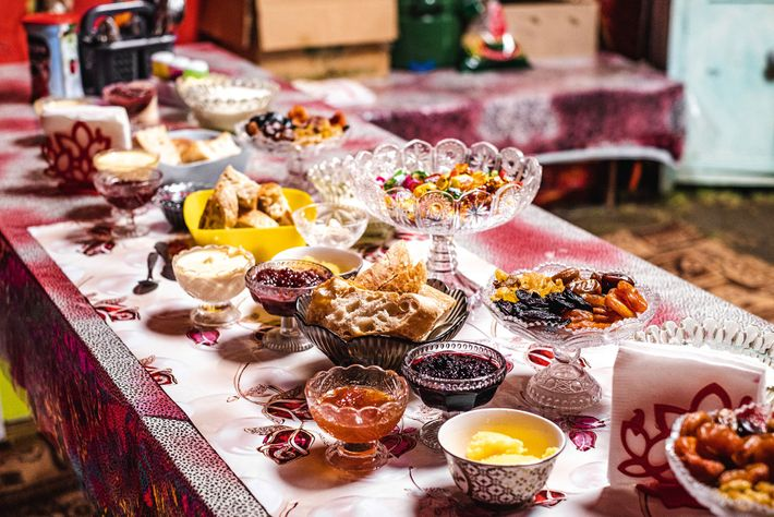 Another example of a typical Kyrgyz afternoon tea spread. Encrusted crystal cups contain shiny jams — ...