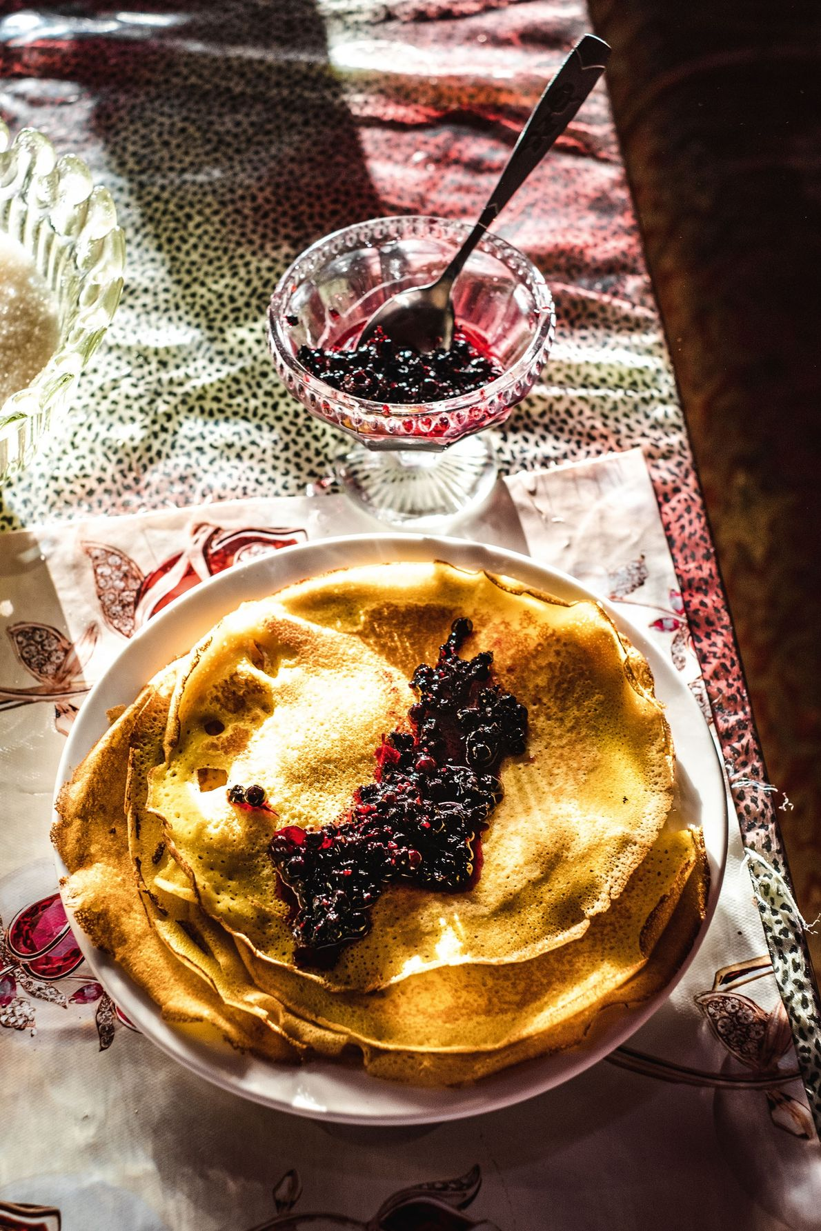 Breakfast is served — a steaming pile of crispy Russian blinis, served with tart homemade jam ...