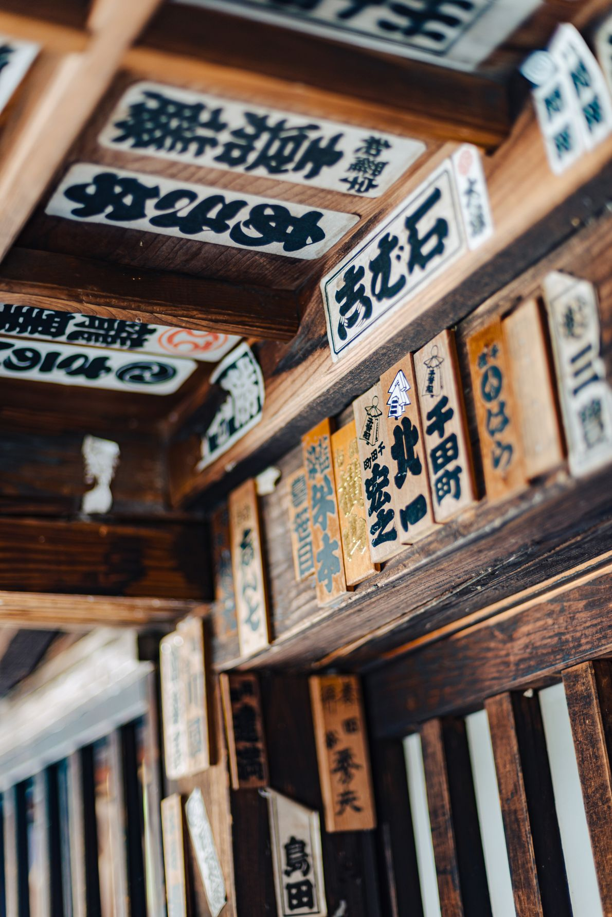Pilgrims may paste their wooden or rice-paper senjafuda (a sign containing their name) on shrines along ...