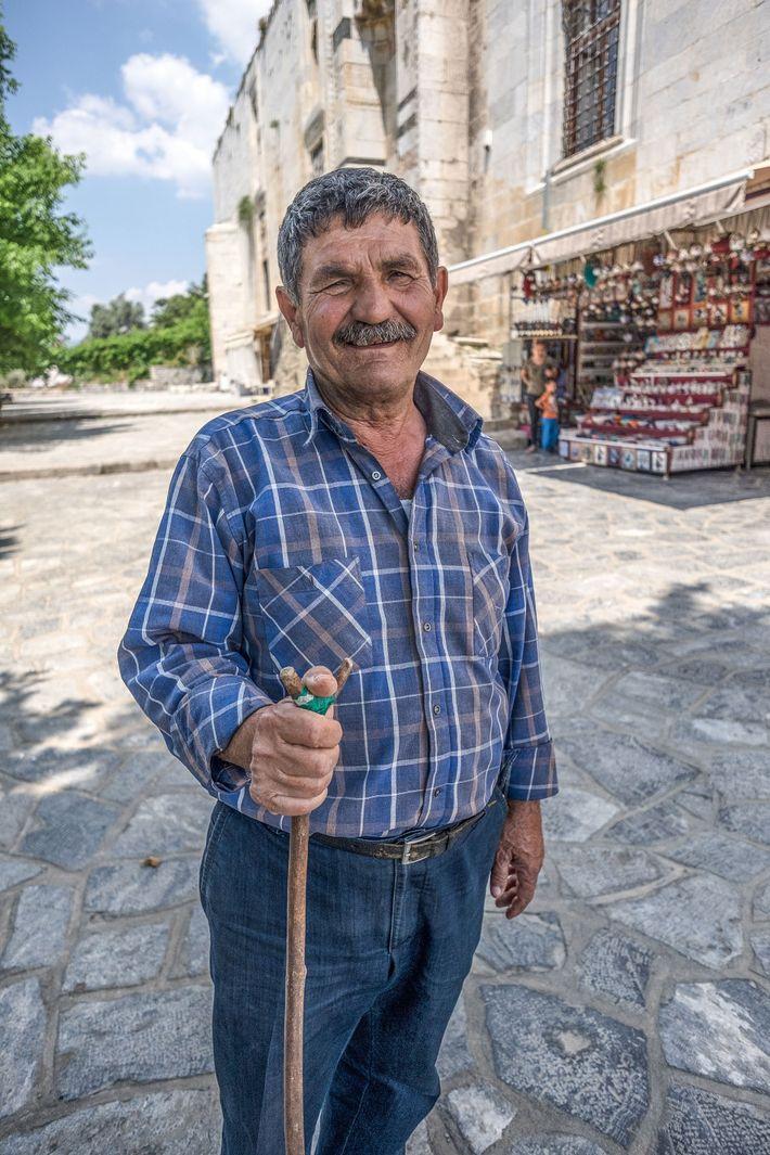 "A Turkish gentleman bids vistors ""hoşgeldiniz"", or ""welcome"", in a small town near the Aegean coast."