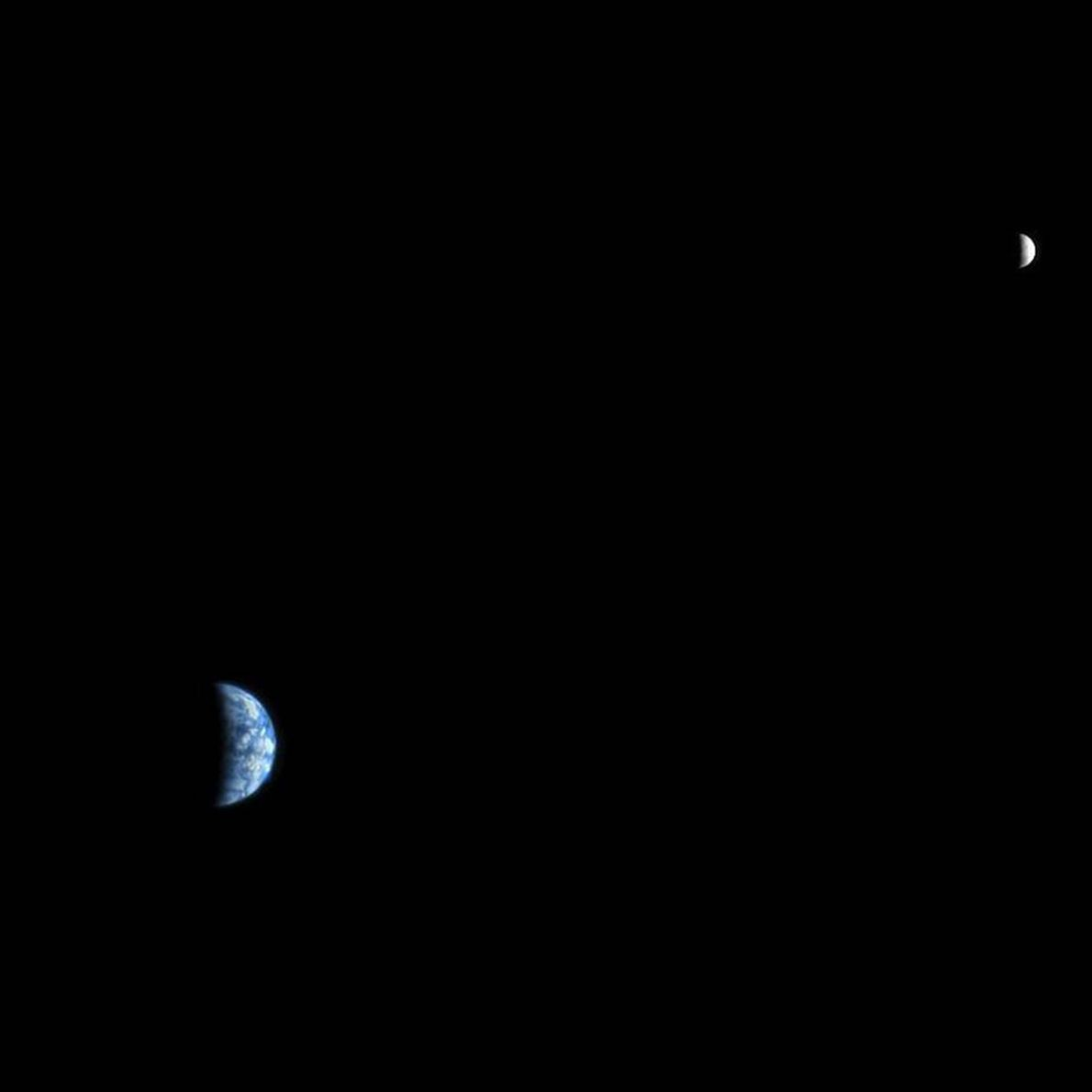 Inky blackness separates Earth and the moon in a picture taken by the Mars Reconnaisance Orbiter, ...