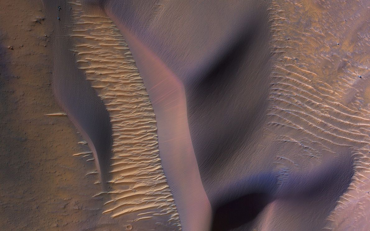 NASA's Mars Reconnaissance Orbiter peers down at the slopes of a mountain within Valles Marineris, the ...