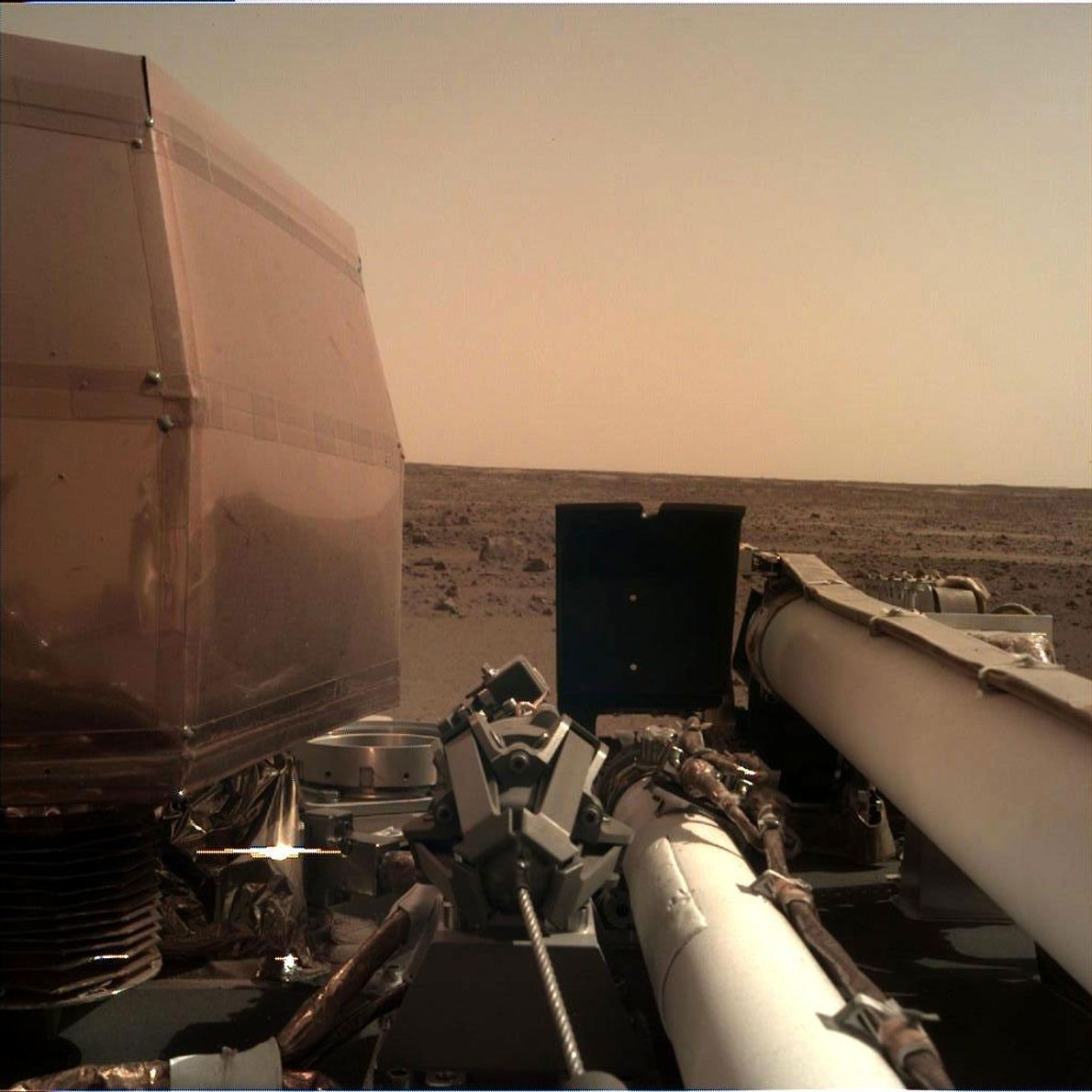 The Instrument Deployment Camera on the robotic arm of NASA's InSight lander took this picture of ...