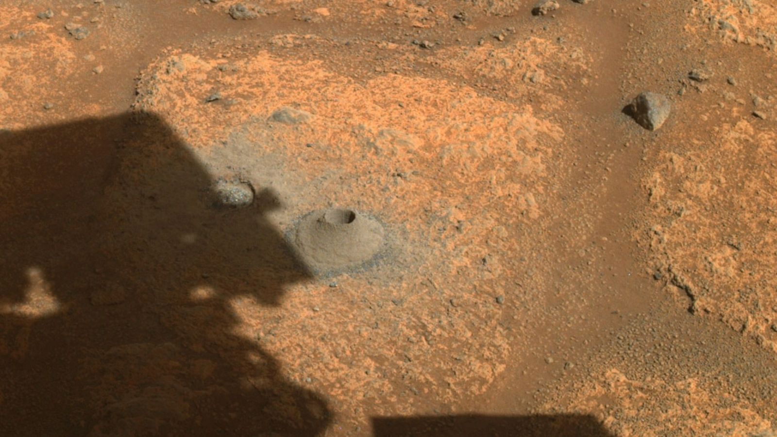 During Perseverance's first sampling attempt, the rover drilled a hole in Mars's surface, shown here, but ...