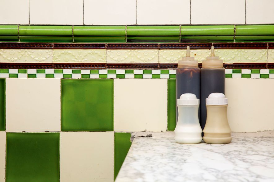 The archetypal Pie 'n' Mash aesthetic of tiled walls and marble surfaces