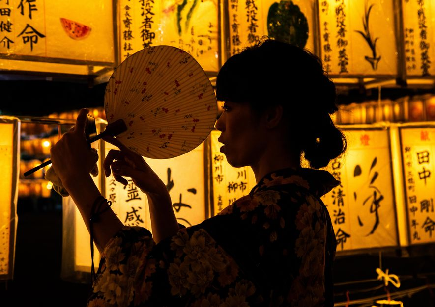 A woman dressed in the traditional Japanese Yukata, at the Gokoku shrine in Japan's Kyushu region ...