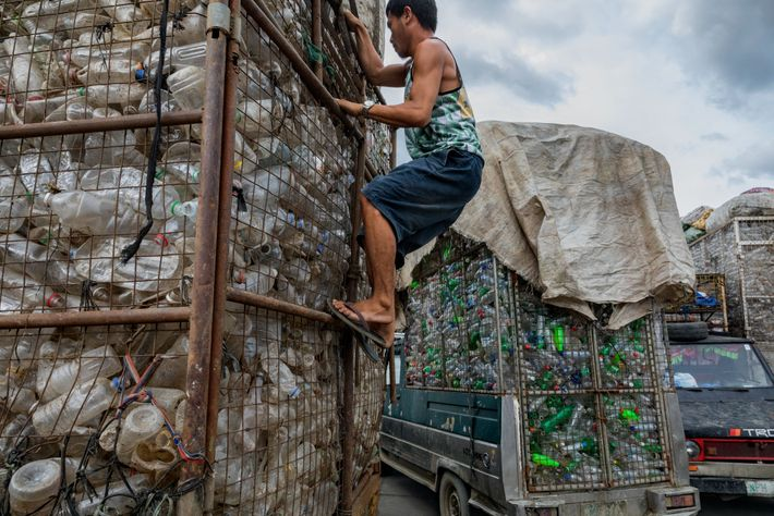Trucks full of plastic bottles pull into a recycling facility in Valenzuela, Philippines. The bottles were ...