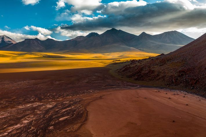 Towering volcanoes surround Chile's Atacama desert, the result of two tectonic plates coming together, with the ...