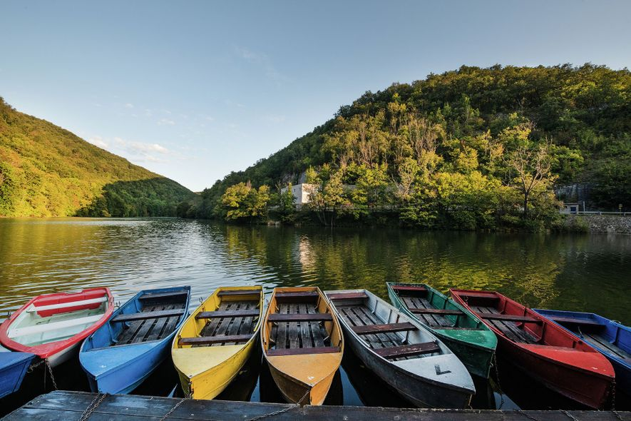 A drifting rainbow of paddleboats lines the shores of the finger-shaped Hámori Lake in Lillafüred. Inthe ...