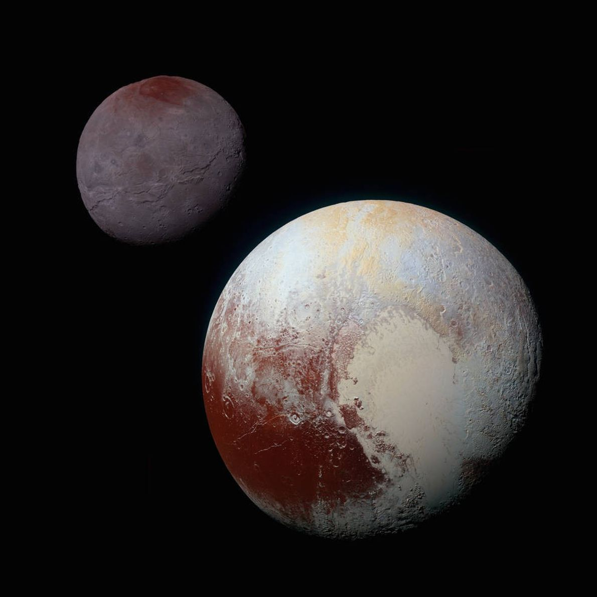 This composite of enhanced colour images of Pluto (lower right) and Charon (upper left), was taken ...