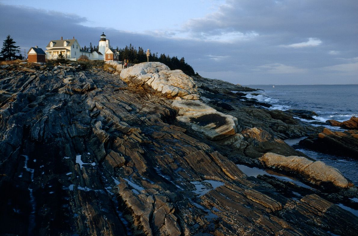 A lighthouse overlooks Pemaquid Point, Maine. Built in 1827, the lighthouse was home to 11 keepers ...