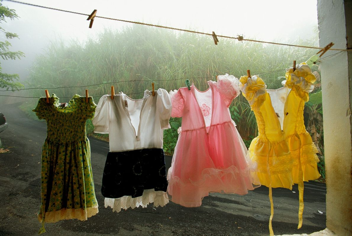 Little dresses hang to dry on a line in Utuado, Puerto Rico. A March 2003 story ...