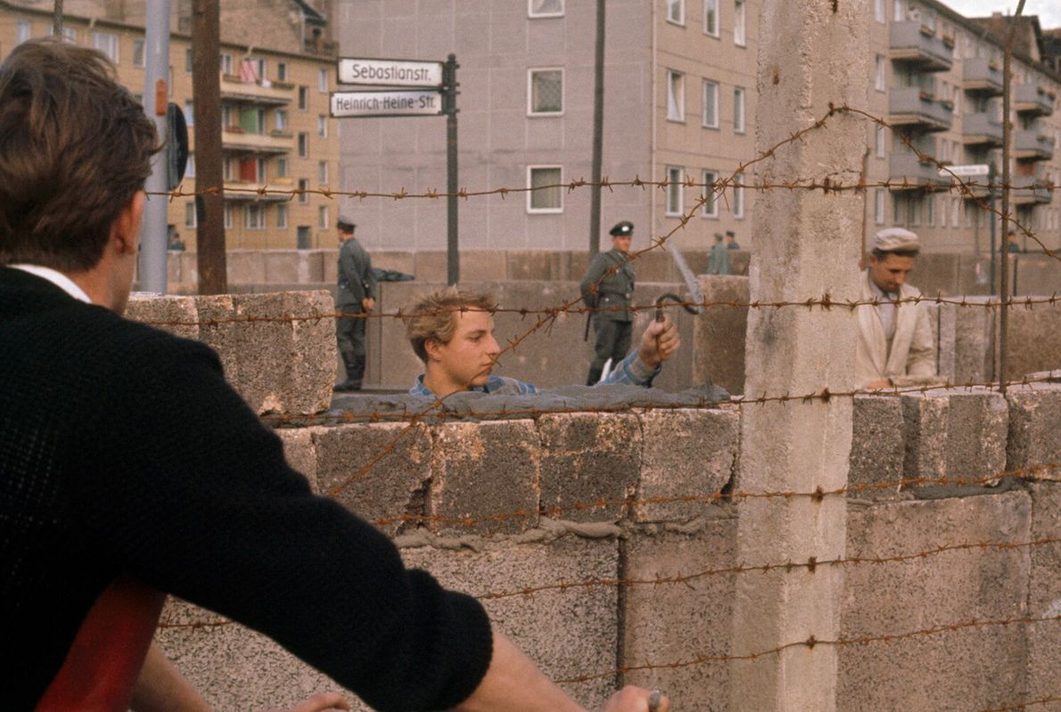 In this picture from the December 1961 issue, workers in West Germany build the Berlin Wall. ...