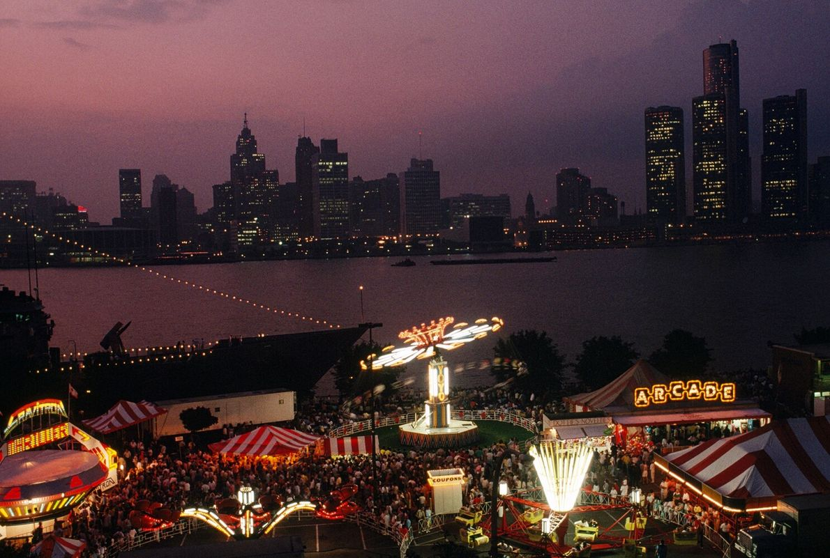 A carnival in Windsor, Ontario, looks out over Detroit, Michigan. A story in the February 1990 ...