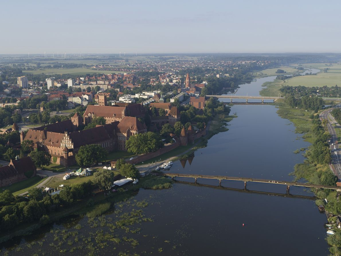 An aerial view of Malbork Castle, a 13th-century Teutonic castle along the Nogat River in Poland.