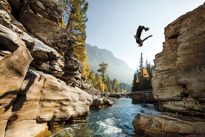 Steven Donovan, flipping into a pool, took a seasonal job at Glacier National Park to sharpen ...