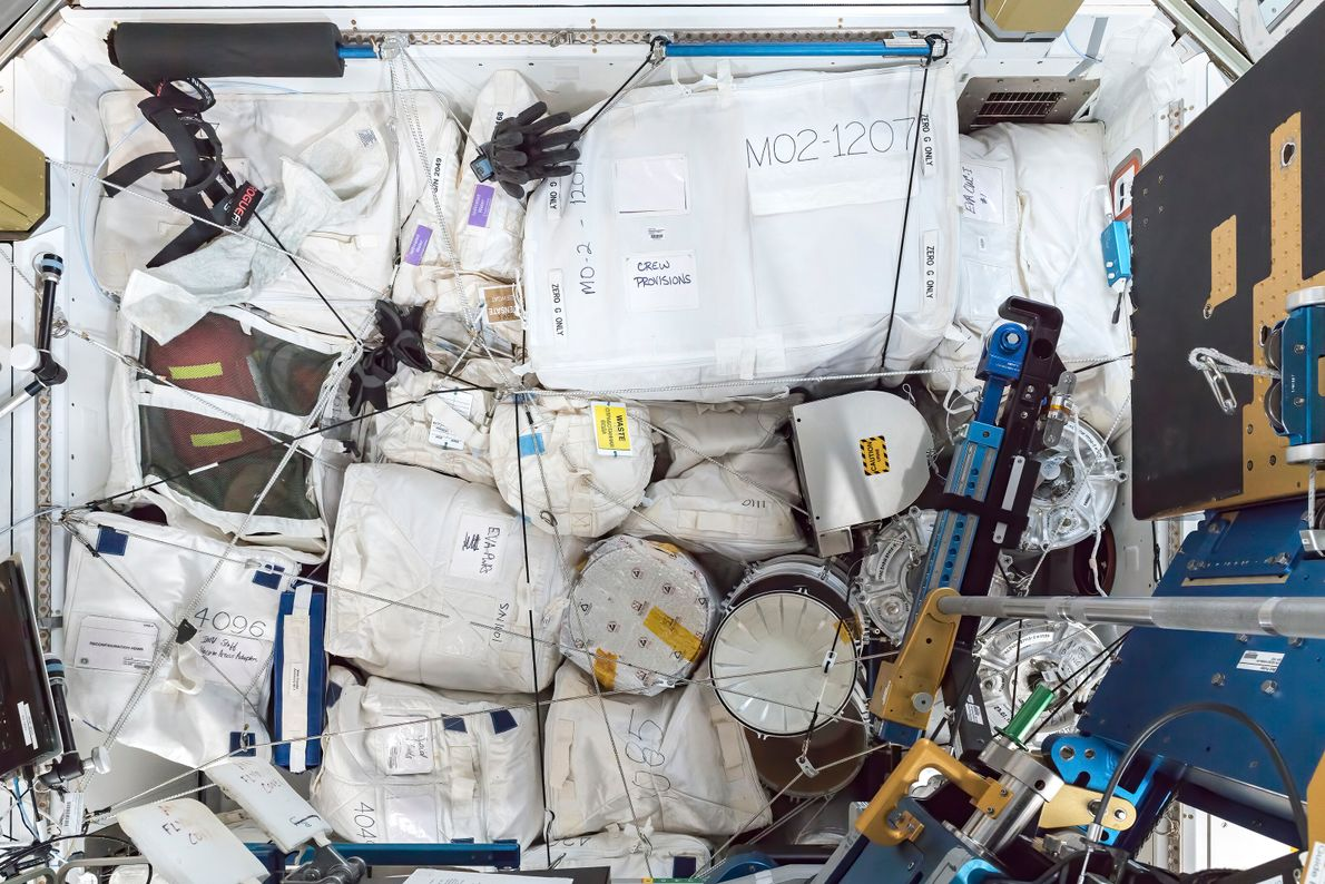 Crew provisions and equipment in storage in the port endcone. The ISS is resupplied via automated craft ...